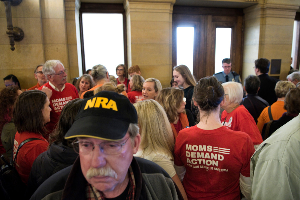 Proponents and opponents to two firearms bills being heard by the House Public Safety and Security Policy and Finance Committee gather outside the hearing room prior to the beginning of the hearing.