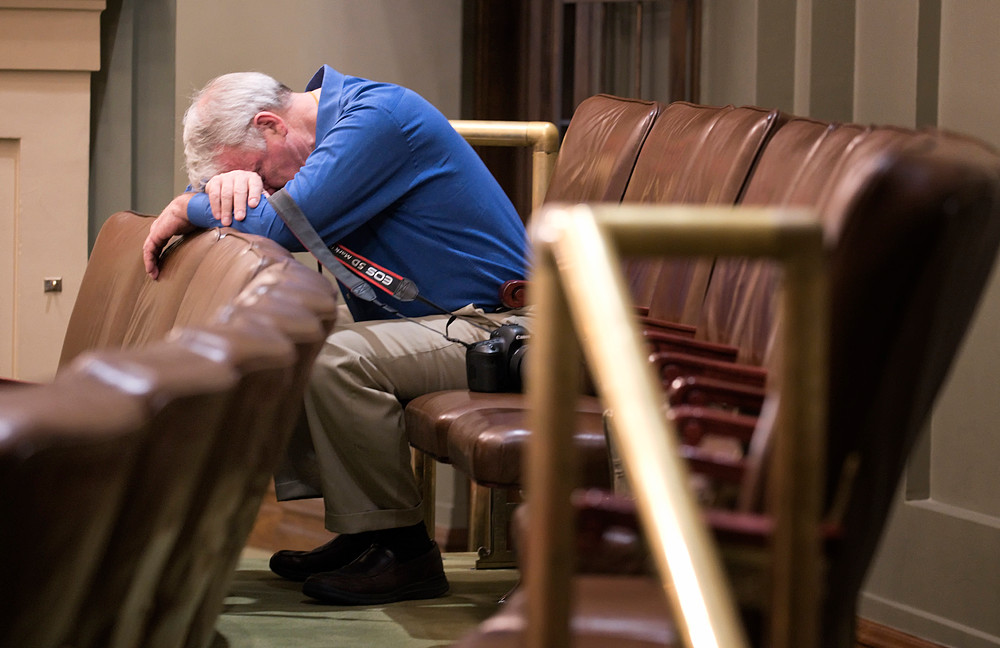 John Kaul finds a place in the House gallery to rest his head before picking up his camera and getting back to documenting the goings on in the halls of the Capitol. A former aide to Senate Majority Leader Nick Coleman and lobbyist, John is the Capitol's storyteller with his photographs of sessions over the years.