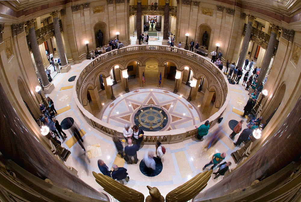 Legislators, staff, lobbyist and visitors mingle on the second floor of the Capitol waiting see the final bills to pass on the last day of the 2018 legislative session before adjournment sine die. Gov. Dayton will have 14 days to sign or veto any of the bills passed by the legislature.