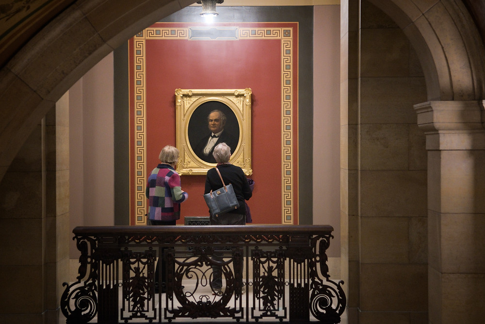 Visitors to the Capitol take a look at the portrait of Gov. Alexander Ramsey the second governor of Minnesota. Portraits of the governors have begun to be hung again in the Capitol as part of the Capitol Restoration Project.