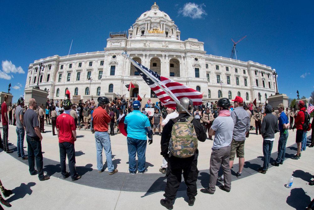 A group that supports the rights of whites stood in a line on one side of the plaza while on the other side an anti-Trump group held the steps of the Capitol. State Troops took up a position between the two groups. Inside the Capitol a peaceful Trump Triumph rally in the rotunda was taking place.
