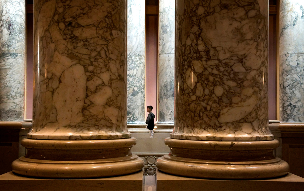A young visitor to the Capitol makes his way around the second floor.