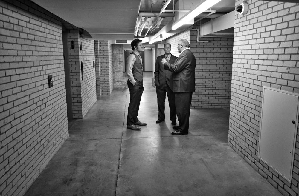 Senate Minority Leader Tom Bakk, right, confers with Senate Majority Leader Paul Gazelka, center and leadership assistant Matthew Steele, left, in the basement of the Capitol.