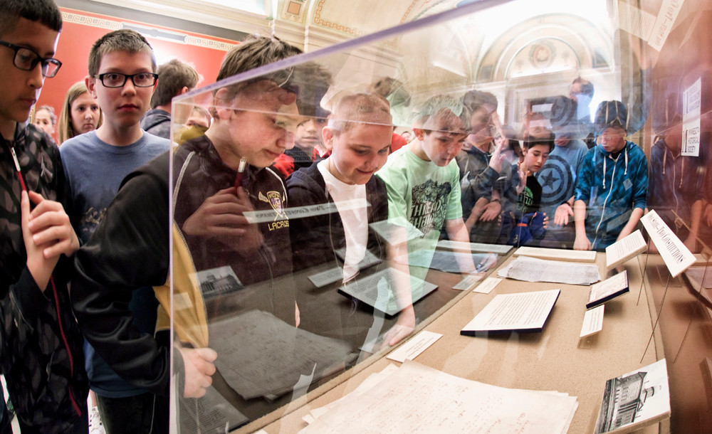Sixth grade students from Clearwater-Wakonia get a look at Minnesota's two State Constitutions in a display cast off the rotunda. The Democrats signed a blue copy and the Republicans signed a white copy of a compromise document. In October 1857 voters approved the constitution.  On May 11, 1858 Minnesota became the 32nd state in the union.