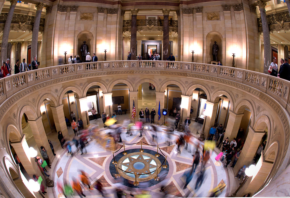 Proponents of Driver's Licenses 4 All circle the Star of the North in the rotunda during a rally sponsored by Movemiento Migrante De Minnesota.