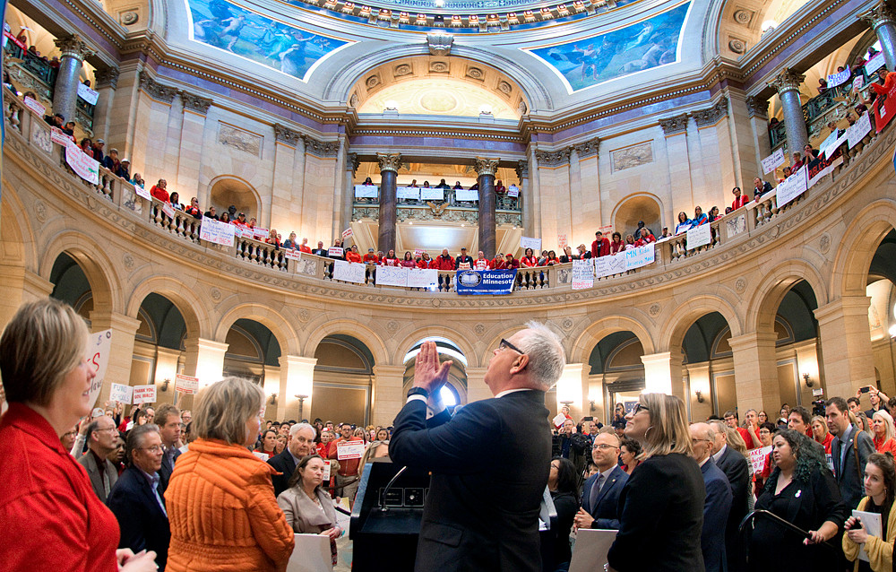 Gov. Tim Walz reacts to the cheers of several hundred teachers and union members at the close of his remarks to an Education Minnesota rally in the rotunda.