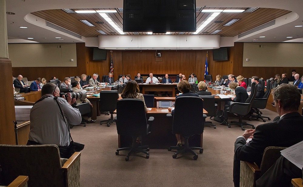 Members of the House Taxes Committee listen to staff present the omnibus tax bill which addresses to conform the state's tax code to new federal tax changes.