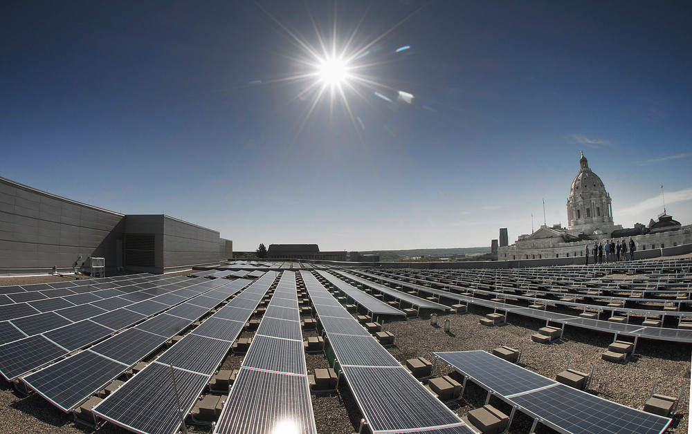 The Minnesota Capitol complex is getting greener with the activation of the first phase of a large new solar array on the roof of the Minnesota Senate Building. The solar project consists of 414 twenty-one square foot panels that produce 133,000 peak watts of direct current power for the building.