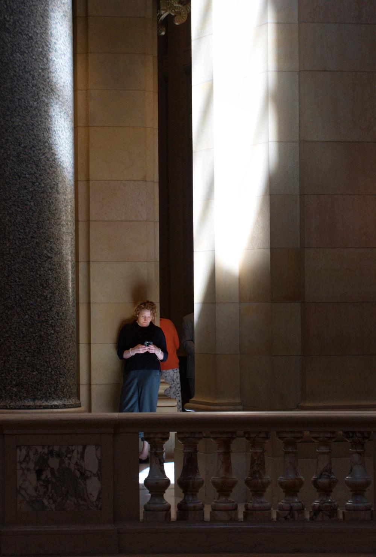 Light reflects off the floor and lights lobbyist Sonnie Elliott.