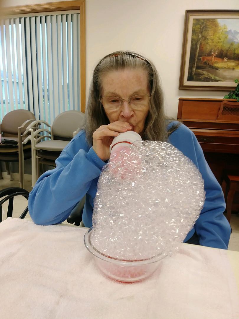senior blowing bubbles