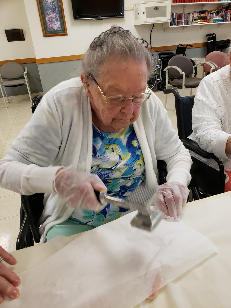 senior making food