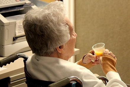 Senior taking medicaton
