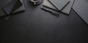 Top view of dark stylish workplace with