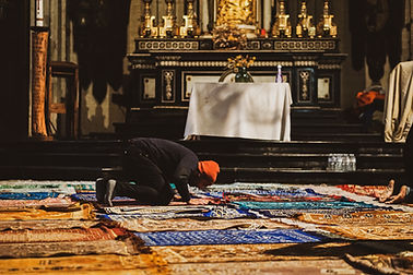 A man praying in the church during the political occupation.