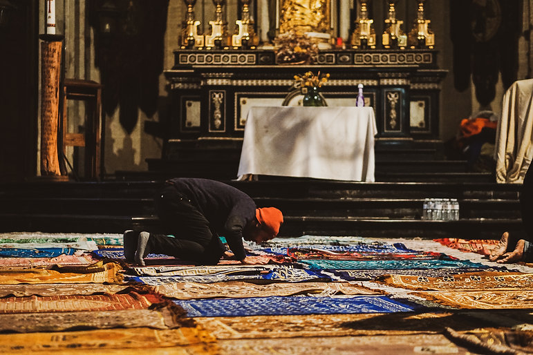 A man praying in the church during the political occupation_