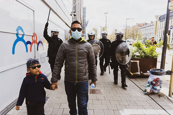 An undocumented father and his son are being chased after one of the peaceful demonstratio