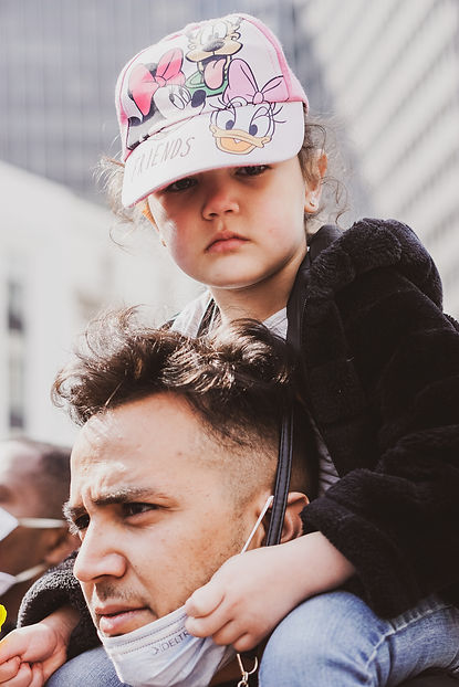 A man and a child during one of the many demonstrations of the USPR, L'union des Sans Papi