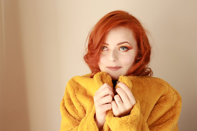 Lucy Edwards in a yellow fleece