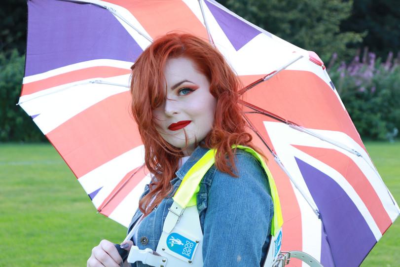 Lucy Edwards holding a Union Jack umbrella