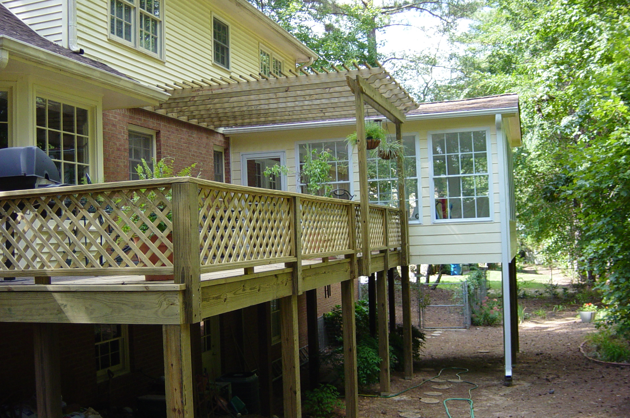 sunroom_pine deck with pergola and lattice.jpg