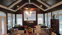 Beautiful sunroom int fireplace built in benches.JPG
