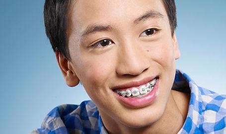 Healthy smiling teen wearing braces