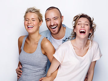 Smiling adults wearing Invisalign invisible braces