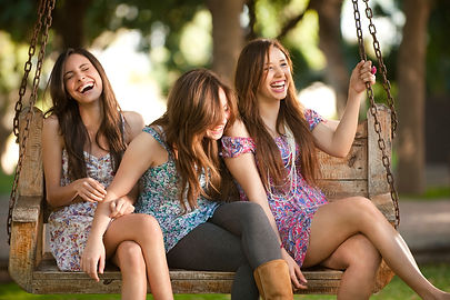 Smiling teens wearing Invisalign invisible braces