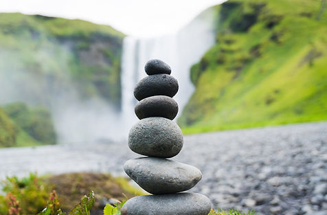 Round stones are stacked to represent balance and alignment.