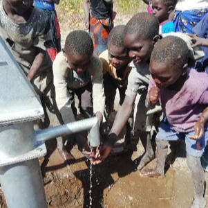 Children taste their first drops of clean drinking water