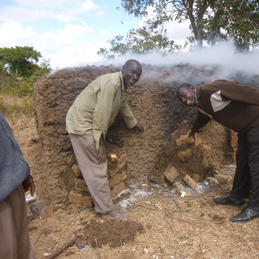 Buildings Officer inspects bricks fired by community