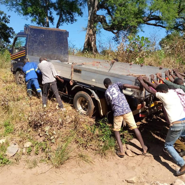 Lorries carrying building material stuck in dry river bed