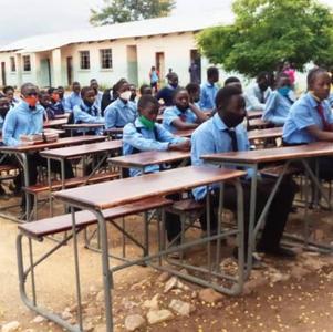 February 2021 children show off the new desks outside