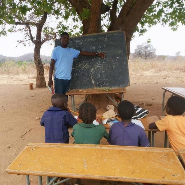 Outdoor classrooom before we built school