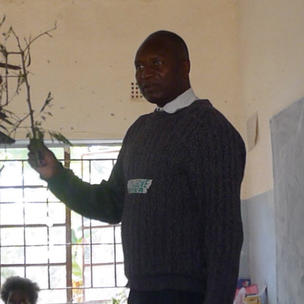 Mr Nyika teaching sharing cuttings