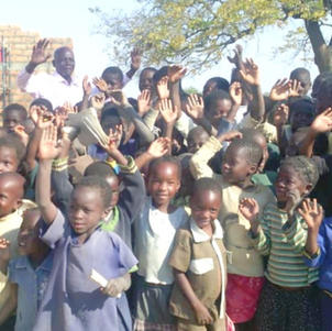 Children excited watching their school being built