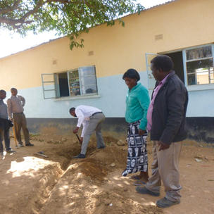 learning to dig drainage  ditches prevent soil erosion