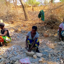 Women crushing stones for foundations