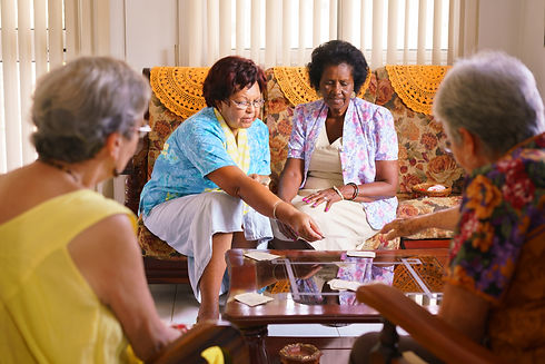 Senior-Women-Playing-Card-Game-In-Hospic