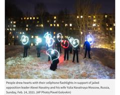 Russians hold 'flashlight protests' in support of Navalny