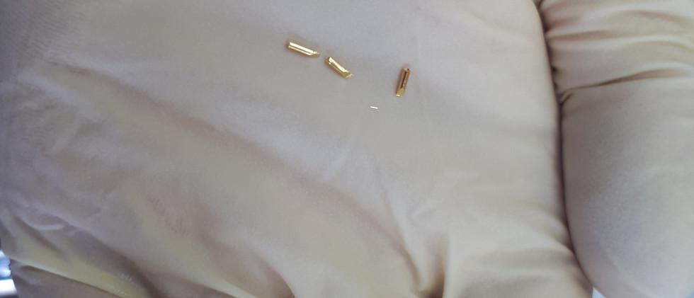 Капсулы из 24-каратного золота