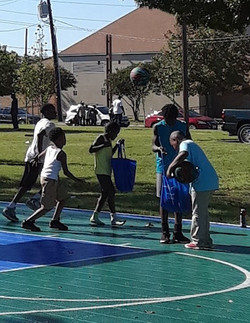 Harambee Kids playing on Court