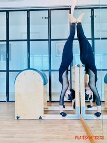 handstand on ladder barrel