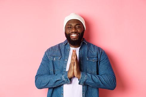 Happy smiling Black man saying thank you