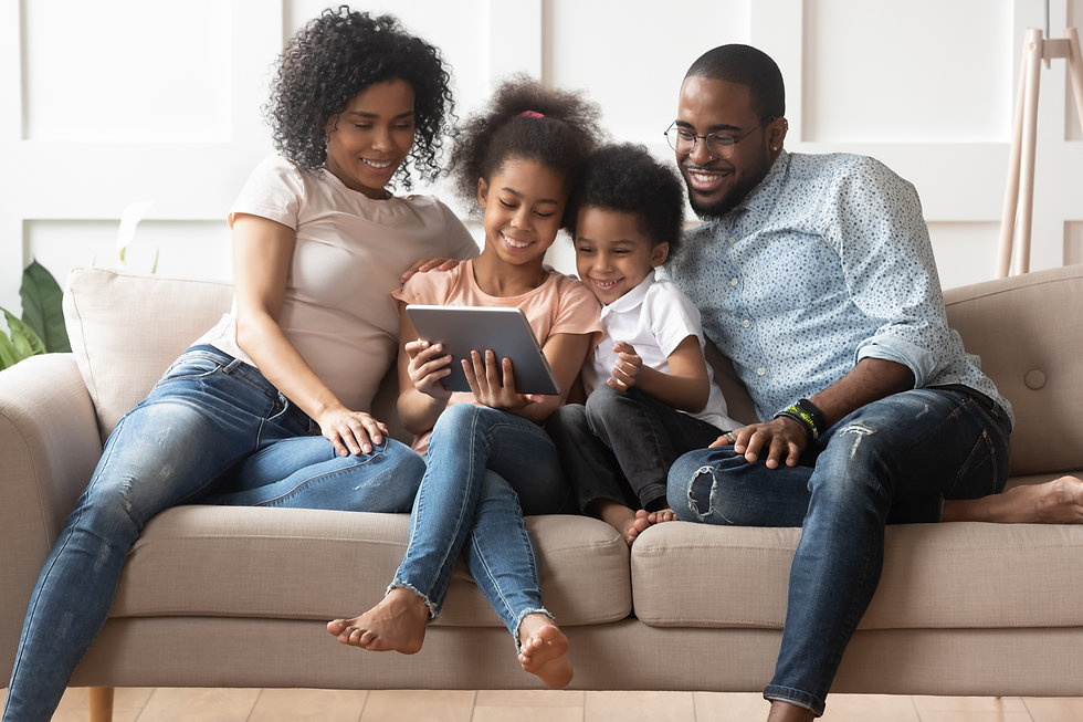 Smiling young african American family si