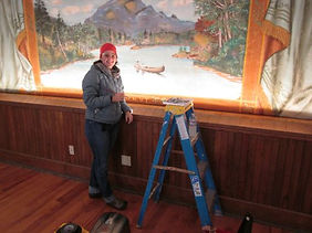 Conservation Assistant Wylie Garcia inpainting a stain
