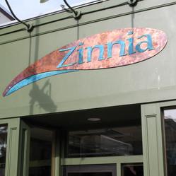 Zinnia Building Mounted Sign Church Street Marketplace
