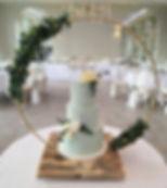 Gold hoop cake stand at a wedding at Deer Park, Devon.