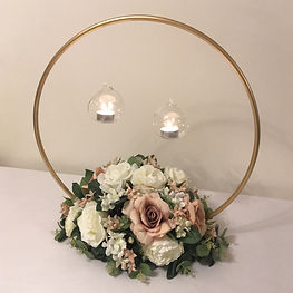 Gold hoop centrepieces available for hire for weddings in Devon and Torbay.