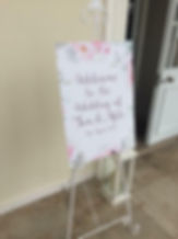 White ornate easel at a wedding at Rockbeare Manor, Exeter.